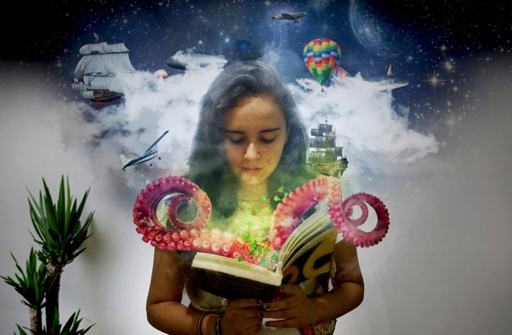 girl reading book with magic coming out