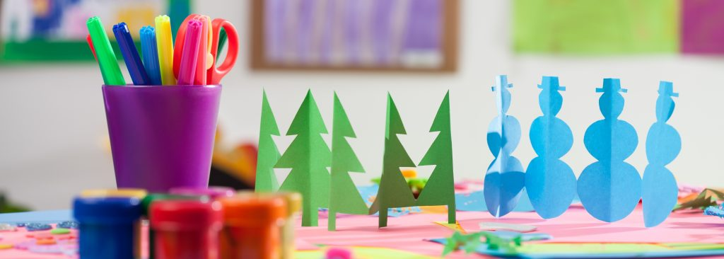 Colourful cutouts, pens and paints in a kindergarden