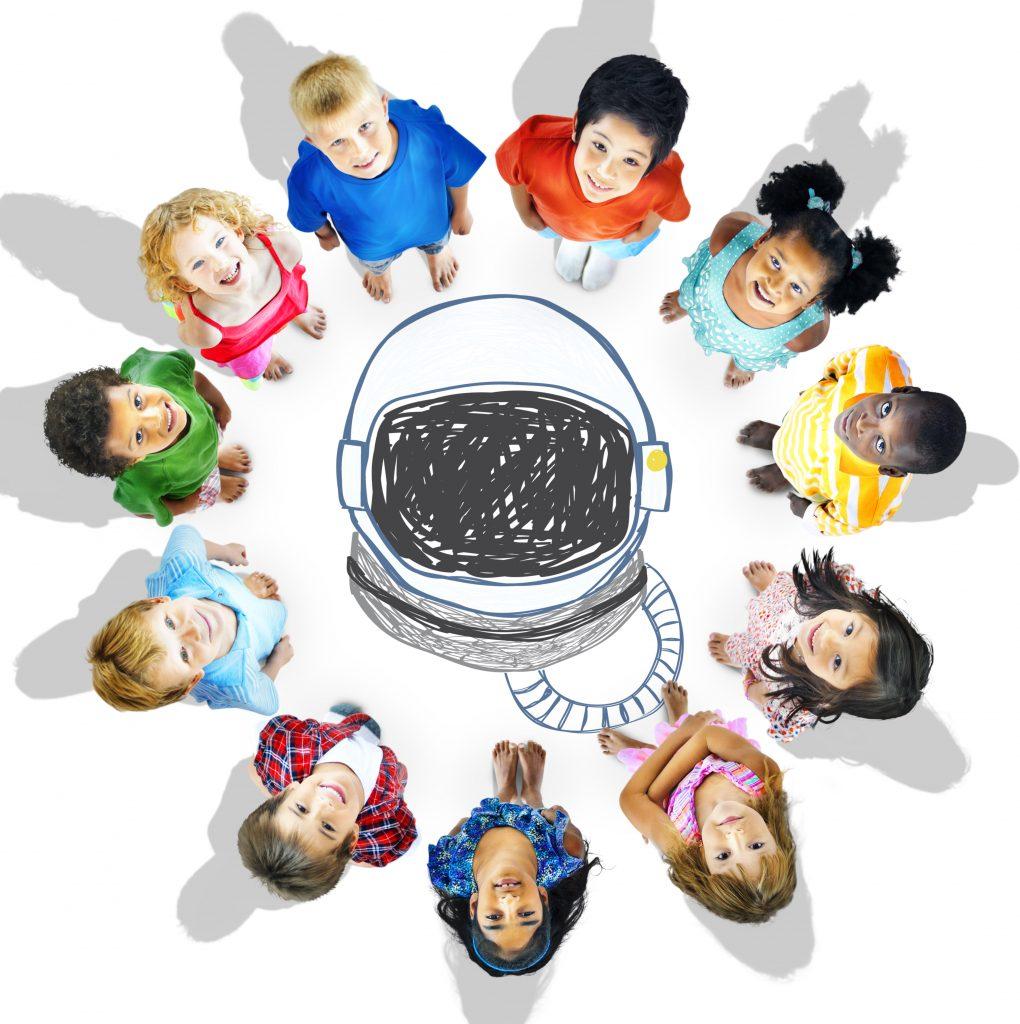children stood around an astronauts helmet.