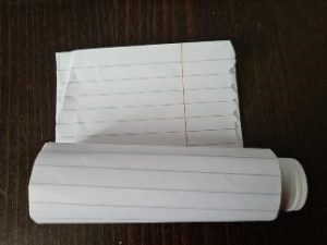 Paper rolled around a glue stick