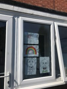 rainbow picture in a window